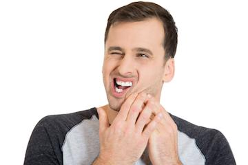 Man wincing from toothache
